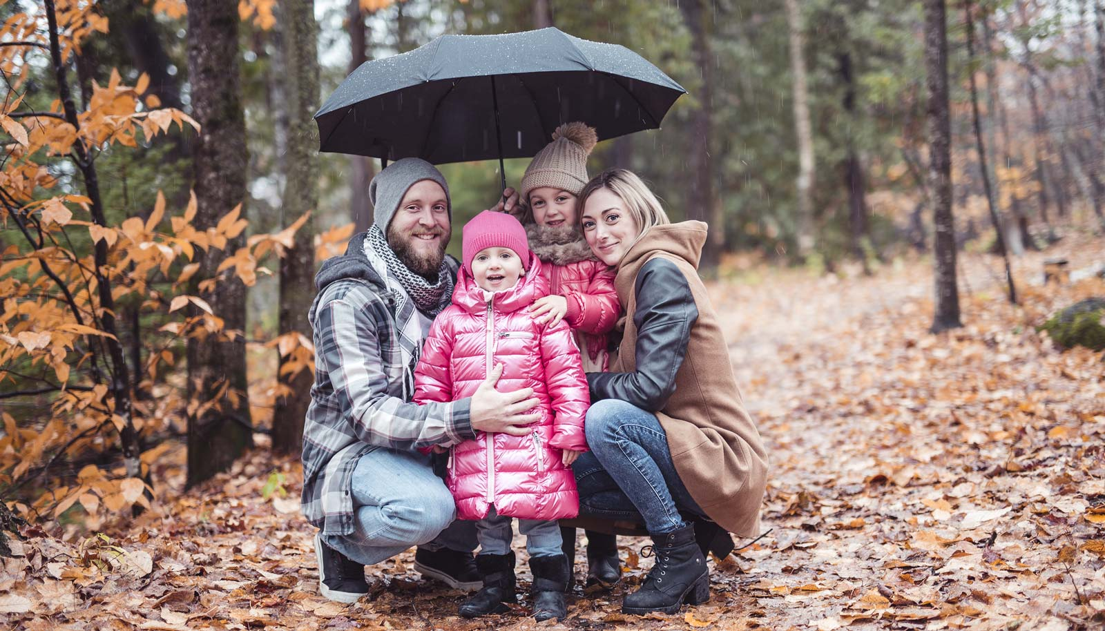 Family covered with umbrella insurance